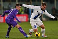 """Antonio Cassano (right) dribbles past Fiorentina's Gonzalo Javier Rodríguez at a game in Florence last month. The Inter Milan striker has named his newborn son after """"the greatest player of all time"""", namely Lionel Messi in his view"""