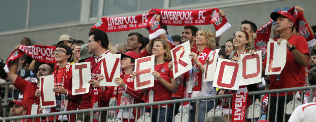 Liverpool fans cheer during the team's 2-0 win over AC Milan during a Guinness International Champions Cup soccer match in Charlotte, N.C., Saturday, Aug. 2, 2014. (AP Photo/Bob Leverone)