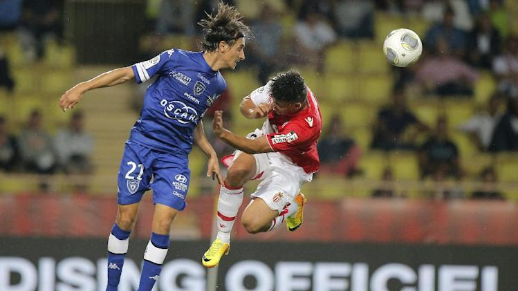 Bastia's Fethi Harek of Algeria, left, challenges for the ball with Monaco's Emmanuel Riviere of France during their French League One soccer match, in Monaco stadium, Wednesday, Sept, 25, 2013