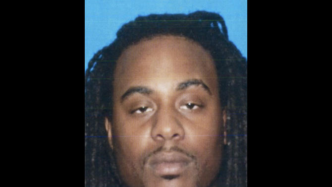"This April 2011 photo from the California Department of Motor Vehicles shows Kenneth Cherry Jr., also known as rapper ""Kenny Clutch."" The Clark County, Nev., coroner's office identified Cherry as the Maserati driver who died Thursday, Feb. 21, 2013 after being peppered with gunfire from someone in a Range Rover SUV, sparking a fiery crash that killed two others in Las Vegas. (AP Photo/California DMV)"