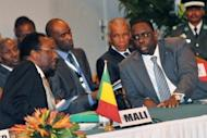 Dioncounda Traore (L), the interim president of Mali speaks with Senegalese President Macky Sall during an emergency ECOWAS summit held to discuss violence and unrest in Mali and Guinea Bissau, in April 2012, in Abidjan