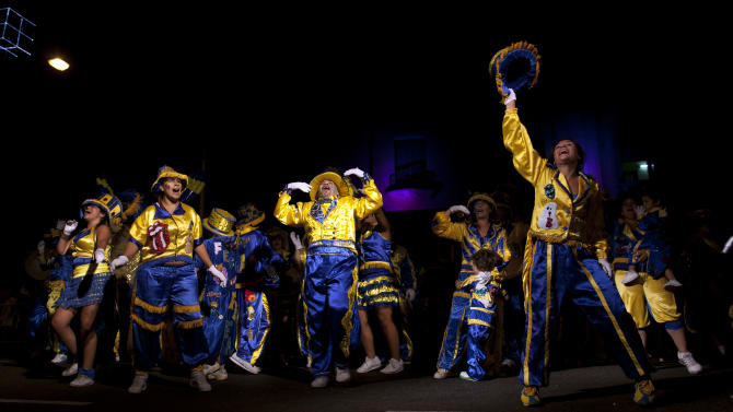 """Members of the murga """"Los amantes de La Boca"""" perform during carnival celebrations in Buenos Aires, Argentina, Sunday, Feb. 3, 2013. Argentina's carnival celebrations may not be as well-known as the ones in neighboring Uruguay and Brazil, but residents of the nation's capital are equally passionate about their """"murgas,"""" or traditional musical troupes. The murga """"Los amantes de La Boca,"""" or """"The Lovers of The Boca"""" is among the largest, with about 400 members. It's a reference to the hometown Boca Juniors, among the most popular soccer teams in Argentina and the world. (AP Photo/Natacha Pisarenko)"""