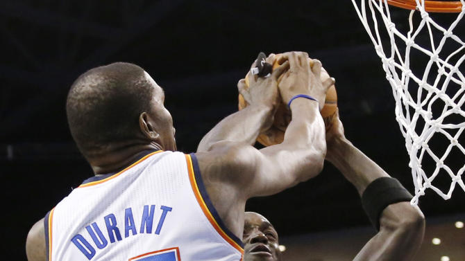 Oklahoma City Thunder forward Kevin Durant (35) blocks a shot by Brooklyn Nets center Kevin Garnett (2) in the second quarter of an NBA basketball game in Oklahoma City, Thursday, Jan. 2, 2014. (AP Photo/Sue Ogrocki)
