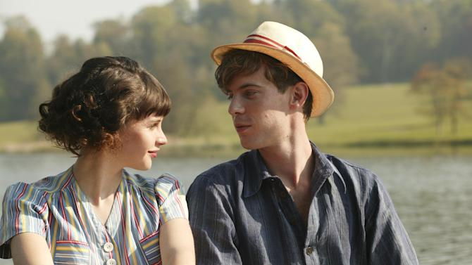 "This film image released by IFC Films shows Felicity Jones as Dolly Thatchum, left, and with Luke Treadway as Joseph Pattern in a scene from ""Cheerful Weather for the Wedding."" (AP Photo/IFC Films, Suzie Blake)"