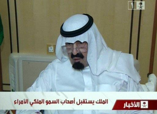 Image grab from Saudi state TV shows Saudi Arabia's King Abdullah appearing on November 28, 2012, for the first time since he underwent a back operation on November 18. The 89-year-old monarch was shown seated and receiving well-wishers at a Riyadh hospital