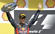 Red Bull Racing's German driver Sebastian Vettel celebrates on the podium at the Spa-Francorchamps circuit in Spa during the Belgium Formula One Grand Prix. Jenson Button claimed his second win this year and 14th of his career when he drove to a comprehensive victory in an incident and accident-packed Belgian Grand Prix