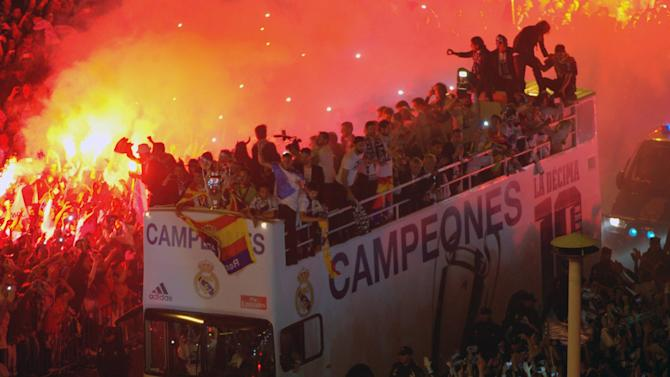 Champions League - Real Madrid fans celebrate on night of contrasting emotions
