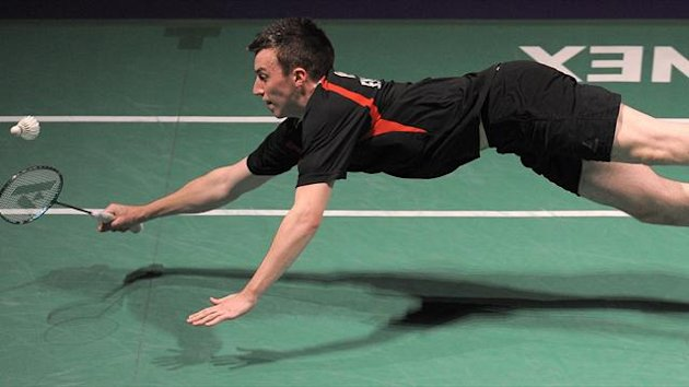 Peter Mills of England dives for a shot during his Quarter final mens double's match against Kindervater and Fuchs of Germany during the European Badminton Championships in Manchester (AFP)