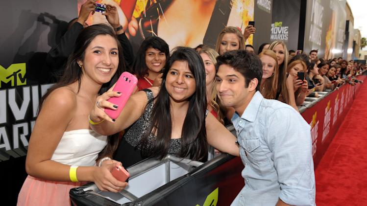 IMAGE DISTRIBUTED FOR MTV - Actor Tyler Posey arrives at the MTV Movie Awards in Sony Pictures Studio Lot in Culver City, Calif., on Sunday April 14, 2013. (Photo by John Shearer/Invision for MTV/AP Images)