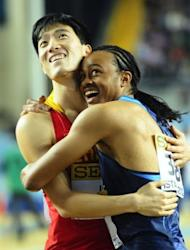 US gold medal winner Aries Merritt (R) embraces silver medallist Liu Xiang of China at the end of the men's 60m hurdles final at the 2012 IAAF World Indoor Athletics Championships at the Atakoy Athletics Arena in Istanbul