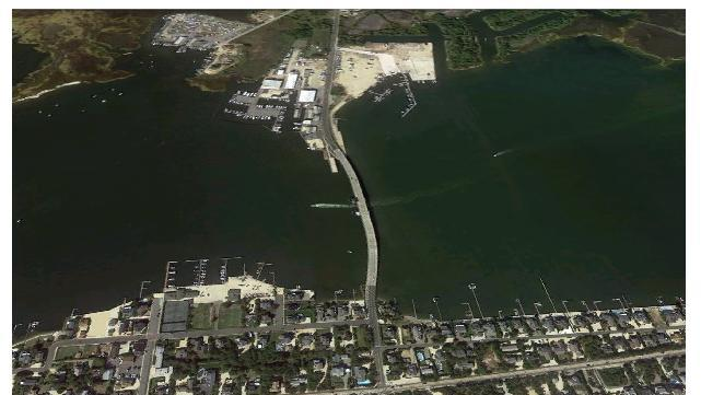 This combo image shows aerial views of Mantoloking, N.J., before and after superstorm Sandy devastated the area.  TOP: This aerial satellite image made on Sept. 20, 2010, from Google Earth, shows Mantoloking, N.J.  BOTTOM: This aerial photo made from a helicopter shows storm damage from Sandy over the Atlantic Coast in Mantoloking, N.J., Wednesday, Oct. 31, 2012. New Jersey got the brunt of superstorm Sandy, which made landfall in the state Monday, Oct. 29, 2012, leaving sections of the Jersey shore, including Mantoloking, with a badly eroded shore, ruined beachfront homes, flooded streets and damaged utilities. (AP Photos/Google Earth, Doug Mills, Pool)