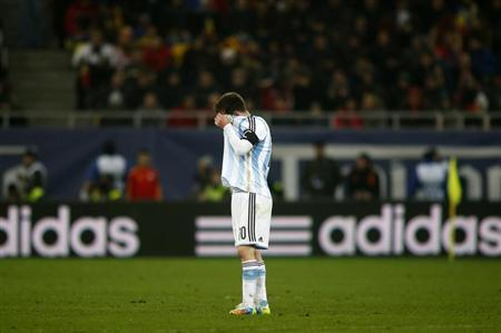 Argentina's Lionel Messi reacts at the end of their international friendly soccer match against Romania at the National Arena in Bucharest March 5, 2014. REUTERS/Bogdan Cristel