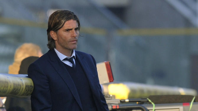 Cagliari coach Diego Lopez, of Uruguay, watches a Serie A soccer match between Parma and Cagliari at Parma's Tardini stadium, Italy, Sunday, Dec. 15, 2013