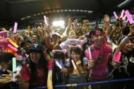 People celebrate after hearing that Tokyo had been chosen to host the 2020 Olympic Games during a public viewing event in Tokyo September 8, 2013. REUTERS/Toru Hanai