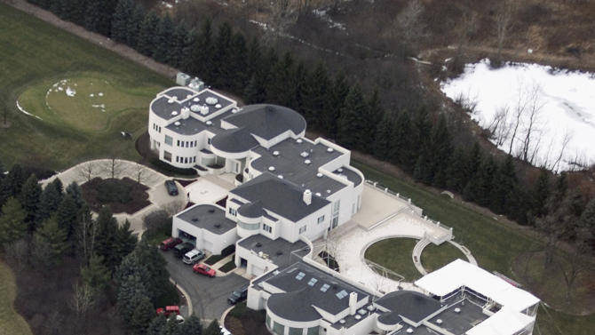 This Jan. 8, 2002 aerial file photo shows the home of former Chicago Bulls star Michael Jordan, in Highland Park, Ill. Jordan's 56,000-square foot home in suburban Chicago is up for auction. Concierge Auctions says the sale will take place Monday, Dec. 16, 2013. The company runs the sales of high-end real estate and features Jordan's Highland Park home north of Chicago on its website