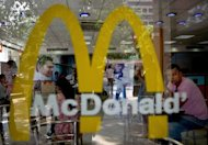 Customers at a McDonald's outlet in New Delhi. US fast-food giant McDonald's, famed for its beef-based Big Mac burgers, on Tuesday said it will open its first vegetarian-only restaurant anywhere in the world in India next year.