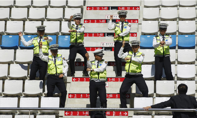 "Policemen rehearse South Korean singer Psy's ""Gangnam style"" dance moves at the grandstand ahead of the South Korean F1 Grand Prix in Yeongam"