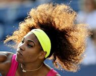 Serena Williams of the US (4) plays against Maria Jose Martinez Sanchez from Spain during their 2012 US Open match in New York on August 30, 2012. Williams won her 60th match at the US Open, advancing to the third round by defeating Sanchez 6-2, 6-4
