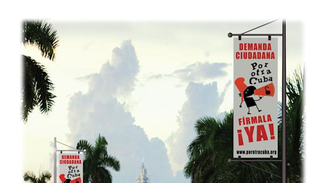 """This image provided by """"For Another Cuba"""" shows a poster created by artist Rolando Pulido that was on display Saturday, May 4, 2013, in Miami as part of the """"For Another Cuba"""" campaign. The works are part of an exhibit held in Miami by State of SATS, an activist group attempting to foster civil society and stimulate discussion about Cuba's future. (AP Photo/For Another Cuba)"""