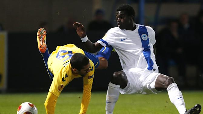 Isaac Sackey, right, of Slovan Liberec challenges Evandro, left, of Estoril Praia during their Europa League Group H soccer match in Liberec, Czech Republic, Thursday, Oct. 3, 2013