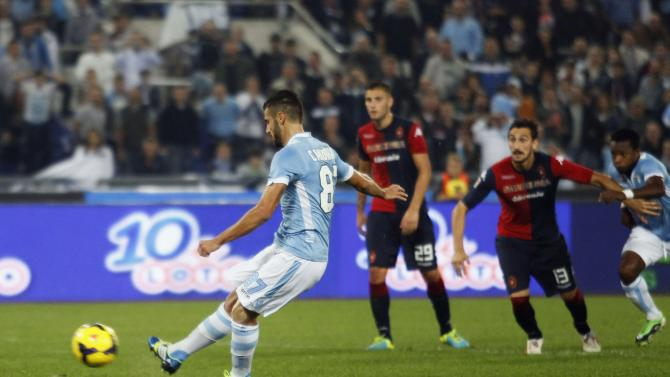 Lazio's Candreva scores on a penalty against Cagliari during their Italian Serie A soccer match at the Olympic stadium in Rome