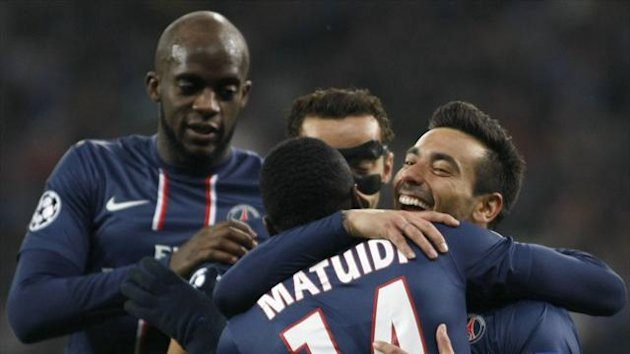 Paris St Germain's Ezequiel Lavezzi (R) celebrates with team-mates after scoring a goal