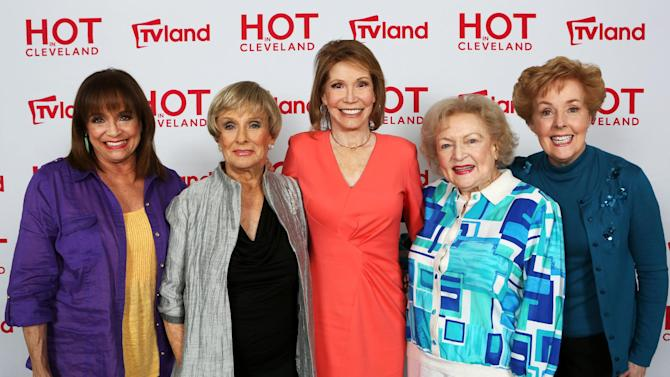 "In this April 4, 2013 publicity photo released by courtesy of TV Land shows, from left, actresses Valerie Harper, Cloris Leachman, Mary Tyler Moore, Betty White and Georgia Engel, former co-stars of the '70s TV classic ""The Mary Tyler Moore Show,"" posing after a press conference discussing their reunion for an upcoming episode of sitcom ""Hot in Cleveland,"" in Los Angeles. (AP Photo/Courtesy TV Land, Danny Feld)"