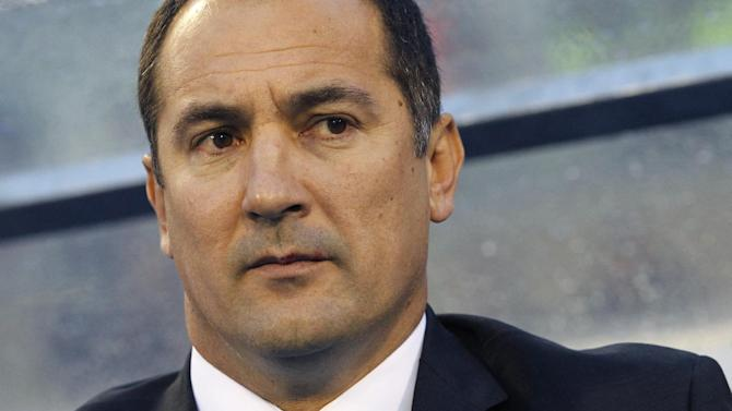 In this photo taken Friday, Oct. 11, 2013, Croatia's former head coach Igor Stimac watches their group A World Cup qualifying soccer match against Belgium, in Zagreb, Croatia. Stimac was sacked after defeats by Scotland and Belgium. Croatia's Football Federation on Wednesday, Oct. 16, 2013, named former Croatian midfielder and coach of the junior national team Niko Kovac as his temporary replacement