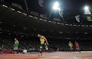 Brazil's Alan Fonteles Cardoso Oliveira (L) beats South Africa's Oscar Pistorius (2nd L) in the Men's 200m T44 Final athletics event during the London 2012 Paralympic Games