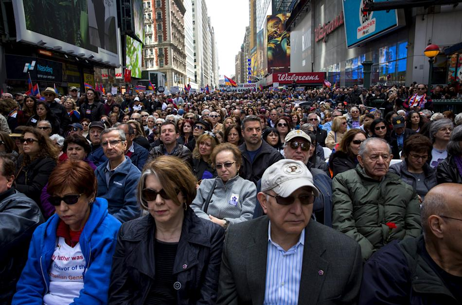 People attend a rally in Times Square to commemorate the 100th anniversary of mass killing of Armenians by Ottoman Turks in New York City