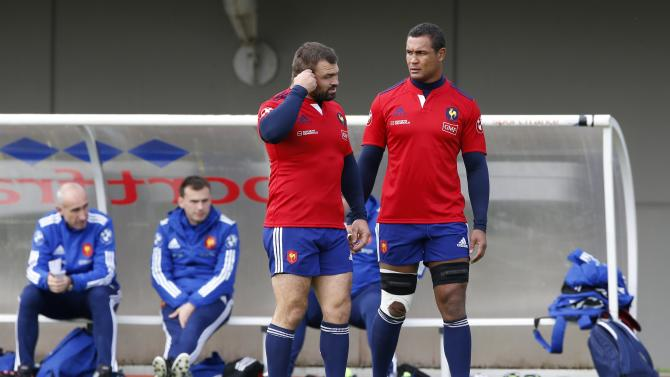 France's national team Captain Dusautoir and player Mas attend a training session at the Rugby Union National Centre in Marcoussis, south of Paris