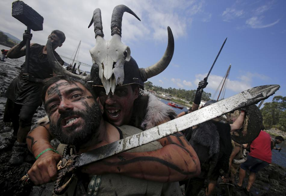 People dressed up as Vikings take part in the annual Viking festival of Catoira in north-western Spain