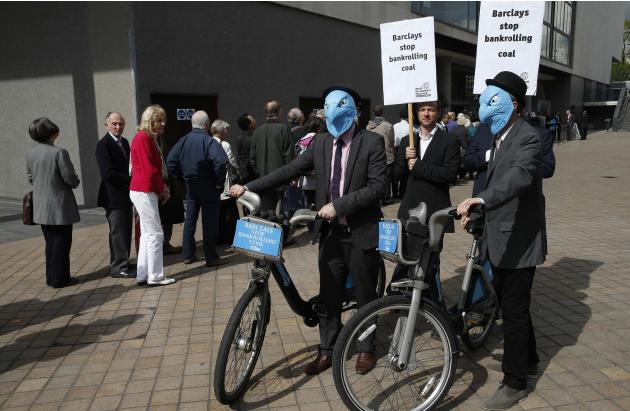 Demonstrators protest as shareholders queue to enter the Barclays AGM in central London