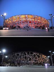 """This combo of pictures shows the National Stadium, known as the Bird's Nest with the lights on (top) and with the lights off (bottom) during the annual """"Earth Hour"""" event in Beijing on March 23, 2013. Iconic landmarks and skylines were plunged into darkness on Saturday as the """"Earth Hour"""" switch-off of lights around the world got under way to raise awareness of climate change."""