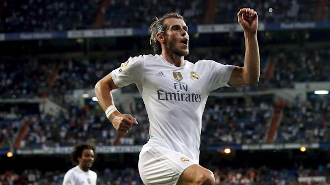 Real Madrid's Gareth Bale celebrates his second goal against Real Betis during their Spanish first division soccer match at Santiago Bernabeu stadium in Madrid
