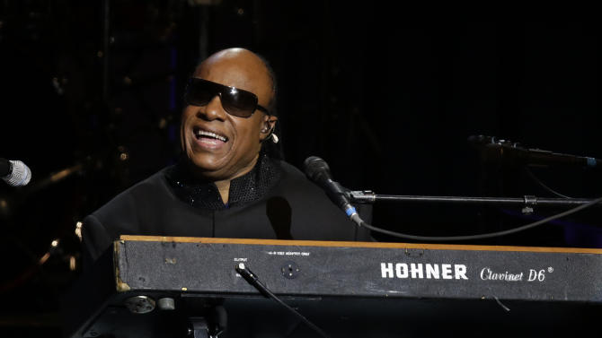 Singer Stevie Wonder performs during the Inaugural Ball at the 57th Presidential Inauguration in Washington, Monday, Jan. 21, 2013. (AP Photo/Paul Sancya)
