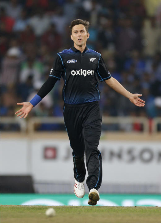 New Zealand's James Trent Boult celebrates the dismissal of India's Axar Patel during the fourth one-day international cricket match against India in Ranchi, India, Wednesday, Oct. 26, 2016. (
