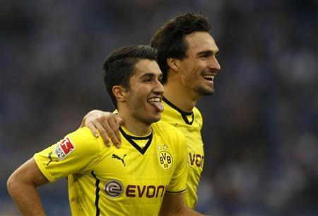 Borussia Dortmund's Sahin and Hummels celebrate a goal against Schalke 04 during the German first division Bundesliga soccer match in Gelsenkirchen