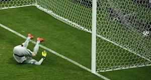 Brazil's goalkeeper Cesar fails to save a shot from Wijnaldum of the Netherlands during their 2014 World Cup third-place playoff in Brasilia