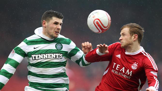 Mark Reynolds, right, is urging Aberdeen to continue their good run by securing a semi-final place