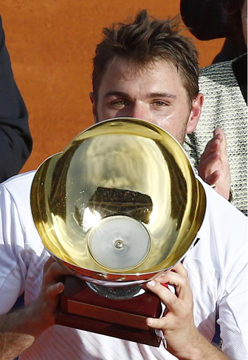 Stanislas Wawrinka of Switzerland holds his trophy after defeating Roger Federer of Switzerland in their final match at the Monte Carlo Tennis Masters tournament,  in Monaco, Sunday, April, 20, 2014.