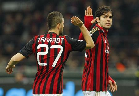 AC Milan's Kaka (R) high fives Adel Taarabt during their Champions League round of 16 first leg soccer match against Atletico Madrid at the San Siro stadium in Milan February 19, 2014. REUTERS/Alessandro Garofalo