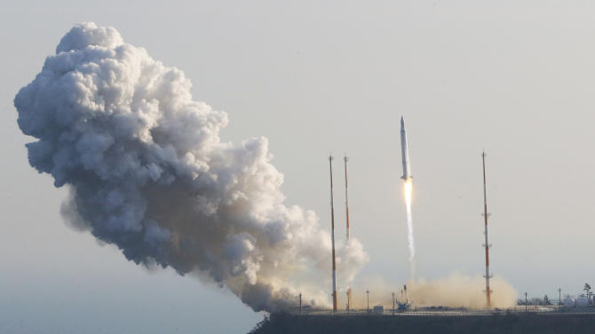South Korea's rocket lifts off from its launch pad at the Naro Space Center in Goheung, South Korea, Wednesday, Jan. 30, 2013. South Korea says it has successfully launched a satellite into orbit from its own soil for the first time. Wednesday's high-stakes launch comes just weeks after archrival North Korea successfully launched its own satellite to the surprise of the world. (AP Photo/Yonhap, Lee Sang-hak) KOREA OUT