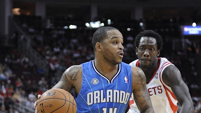Orlando Magic's Jameer Nelson (14) drives the ball past Houston Rockets' Patrick Beverley in the first half of an NBA basketball game Wednesday, Oct. 16, 2013, in Houston