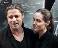 "Brad Pitt and Angelina Jolie met on the set of ""Mr. & Mrs. Smith."""