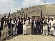Afghan men raise their weapons as they vow to defend their village against Taliban in Dur Baba district of Nangarhar province on August 27. A pro-government Afghan militia commander and his men have shot dead at least eight civilians in revenge, after mistakenly blaming villagers for a Taliban attack, officials said