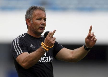 Mihajlovic gestures during a training session in Shenzhen