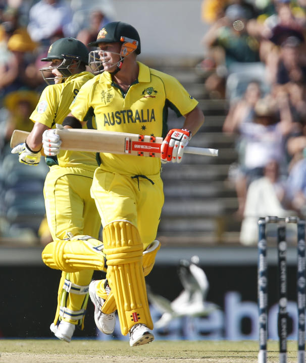 Australia's David Warner completes a run to score a century during their Cricket World Cup Pool A match against Afghanistan in Perth, Australia, Wednesday, March 4, 2015. (AP Photo Theron Kirkman)