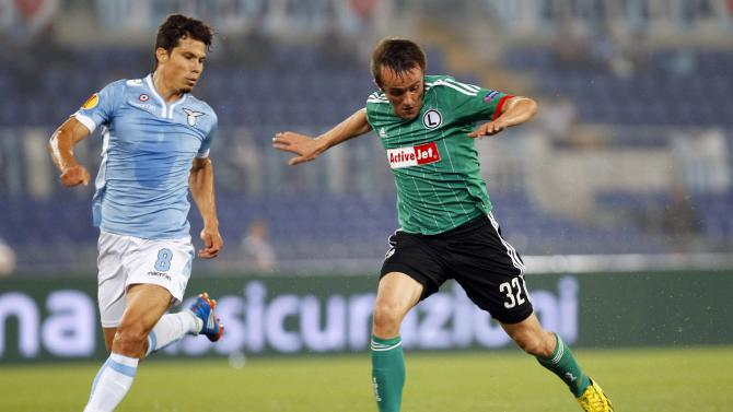 Lazio's Hernanes challenges Legia Warsaw's Radovic during their Europa League soccer match in Rome