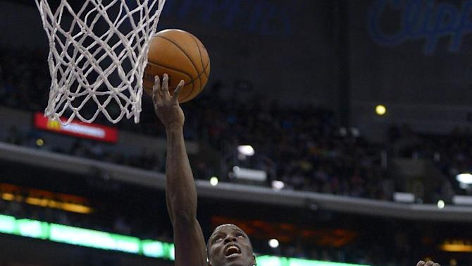 Los Angeles Clippers guard Darren Collison, right, puts up a shot as Utah Jazz guard John Lucas III defends during the second half of an NBA basketball game, Saturday, Dec. 28, 2013, in Los Angeles